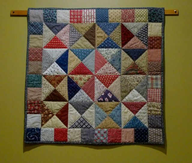 Sara's Flying Triangles, by Sandi Wiseheart. Hand-pieced and hand-quilted, completed Nov 1993.  Exhibited at juried and non-juried conference galleries.