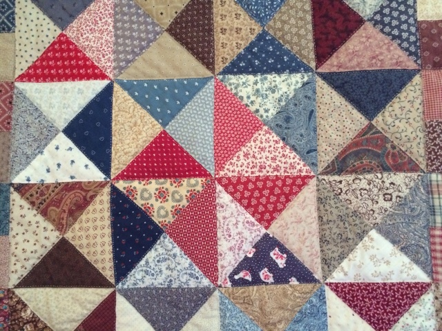"Detail of the ""Flying Triangles"" quilt; hand-pieced and hand-quilted by Sandi Wiseheart"